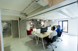 Young programmers sit and work in a modern office