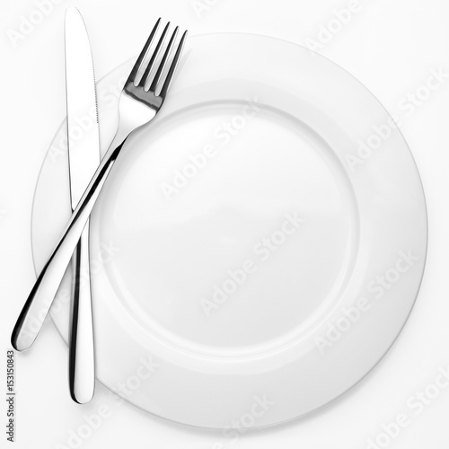 Fotografie, Obraz  Empty plate, fork, knife, white background, isolated, top view from first person