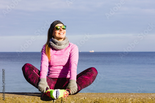 Keuken foto achterwand Ontspanning Woman resting after doing sports outdoors on cold day