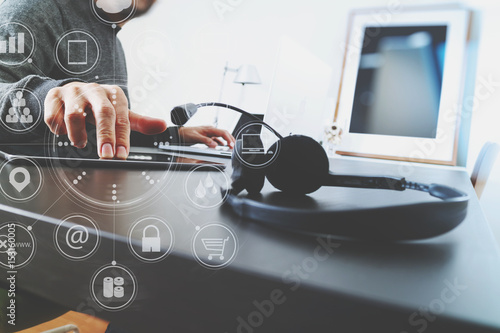 Fotografia Man using VOIP headset with digital tablet computer as concept communication or