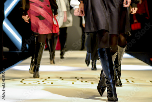 Fotografie, Obraz models are walking - female legs on a fashion show