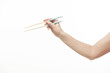 Hand with Chinese chopsticks and pencils