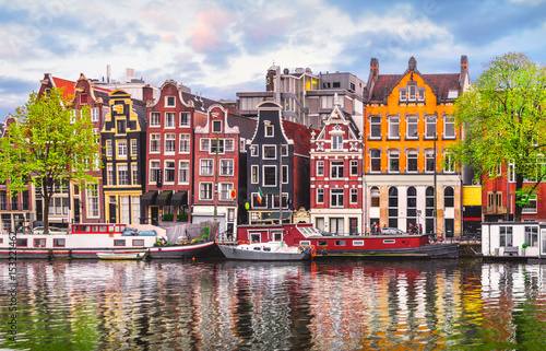 Photo sur Toile Lavende Amsterdam Netherlands dancing houses over river Amstel landmark