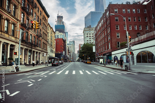 Fototapeta New York City street road in Manhattan at summer time. Urban big city life concept background. obraz