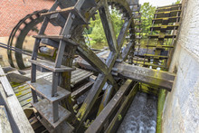 Water Wheels At A Watermill