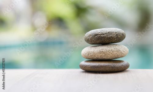 Natural zen stone over blurred background, outdoor day light