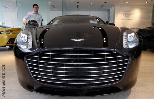 Sales Manager Raymond Liu Switches On The Headlights Of An Aston - Aston martin headlights