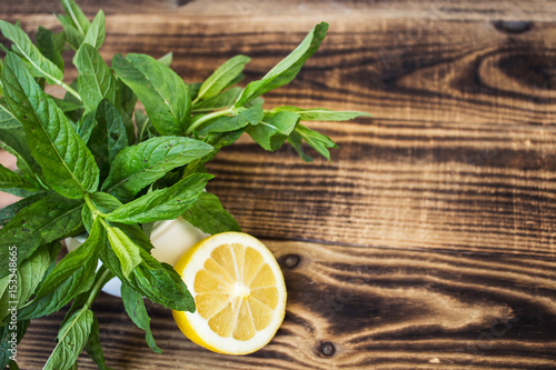 small white vase with fresh mint and lemon Canvas-taulu