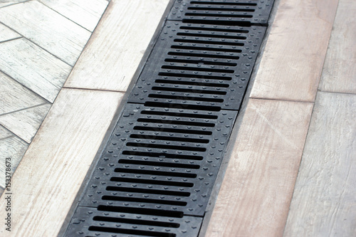 Photo  Rainwater drainage system on a sidewalk