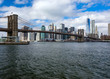 Manhattan skyline and Brooklyn Bridge with waves ot the Hudson river