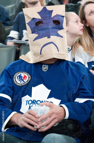 A Toronto Maple Leafs Fan With A Paper Bag Over His Head Attends A Nhl Hockey Game Against The New York Rangers In Toronto Buy This Stock Photo And Explore Similar