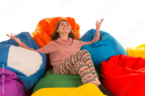 Young happy smiling woman sitting between beanbag chairs Canvas Print
