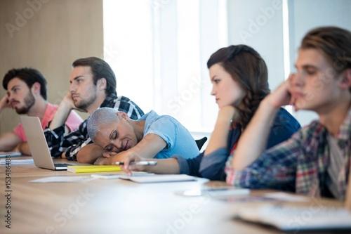 Fotografie, Obraz  Bored creative business team attending a meeting