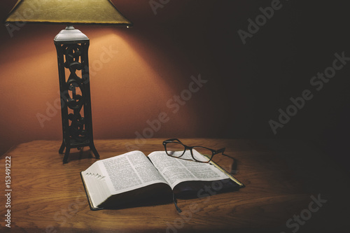 Fotografie, Obraz  Open Holy Bible On Wood Table With Glasses