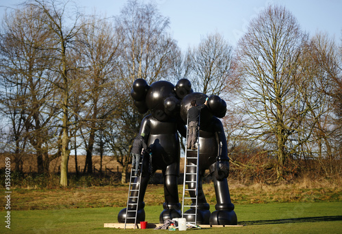 a54cd04c Workers clean a sculpture entitled