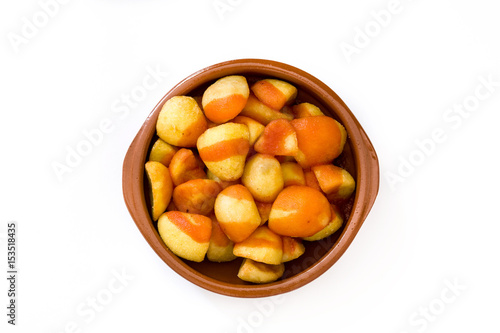 Patatas bravas in bowl isolated on white background