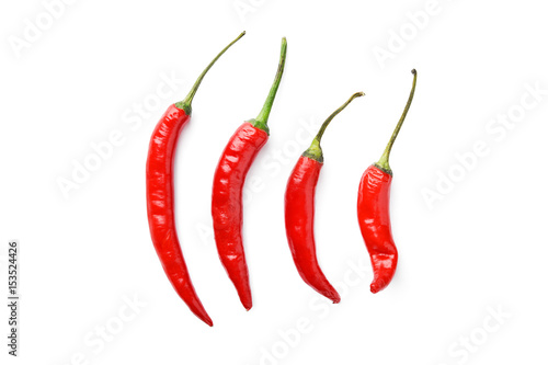 line of hot chili peppers on white background