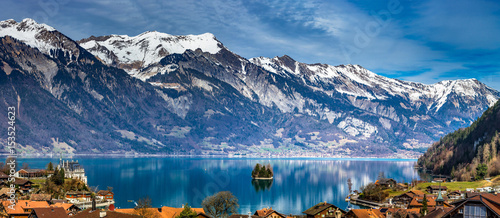 Deurstickers Blauwe jeans Beautiful panoramic view of blue lake in Iseltwald, Switzerland