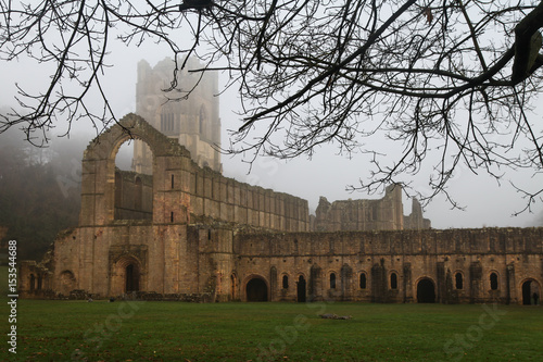 Photo Twelfth Century Fountains Abbey North Yorkshire on a misty day