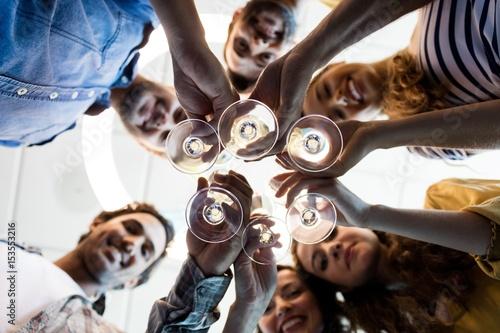 Cuadros en Lienzo Creative business team having a toast on birthday