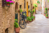 Fototapeta Uliczki - View of an alley in the historic district of Colle Val d'Elsa a small town near Siena in Tuscany