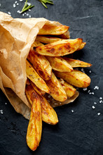 Baked Potato Wedges On A Black...