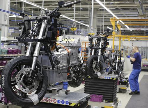 A mechanic assembles BMW C evolution electric maxi-scooter