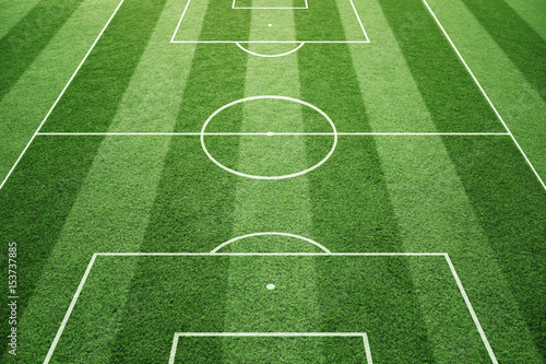 Obraz Soccer play field ground lines on sunny grass pattern background. Goal side perspective used. - fototapety do salonu