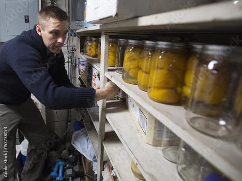 Hugh Vail Inventories His Food Storage At His Home In Bountiful, Utah