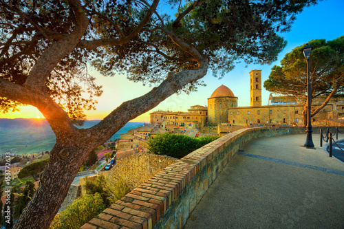 Canvastavla  Tuscany, Volterra town skyline, church and trees on sunset. Italy