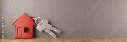 Obraz Schlüssel mit Haus an Wand gelehnt - fototapety do salonu