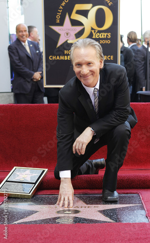 Comedian Bill Maher reaches out to touch his newly unveiled