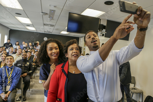 Actor Michael B  Jordan, right, takes a selfie with Attorney General