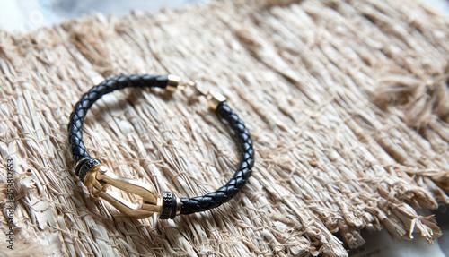Cuadros en Lienzo Gold and leather bracelet