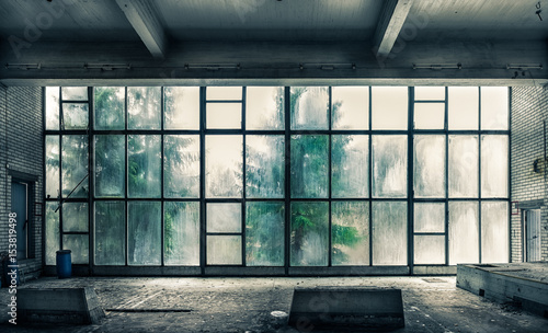The view from an old, abandoned factory on the inside with nice window light