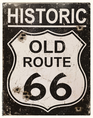 Poster Route 66 Sepia effect retro sign for the historic old Route 66 in America. Faded, vintage style with bullet holes.
