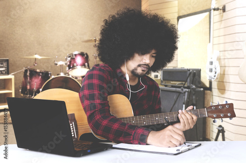 Afro man composing song in music studio Canvas Print