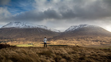 Man Viewing The Scottish Highland Mountains