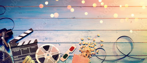 Cinema Film Background - Vintage Effect - Camera With Clapperboard, Tickets, Rolls, Glasses And Popcorn