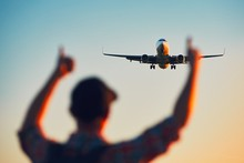 Happy Traveler Watching Airplane Landing