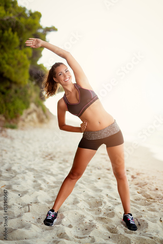 Poster  Girl Exercising On The Beach