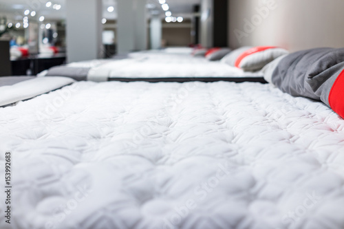 Fotografie, Obraz  Closeup of many mattresses on display in store