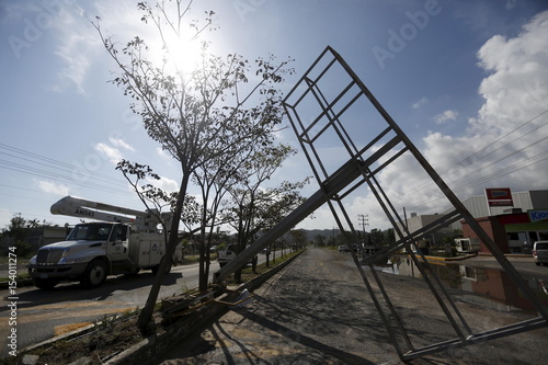 An Advertising Structure Felled By Wind Is Seen After The Passing Of