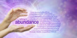 canvas print picture - Attract Abundance Word Cloud - female hands with the word ABUNDANCE  floating between surrounded by a relevant word cloud on a purple pink spiralling vortex energy formation background