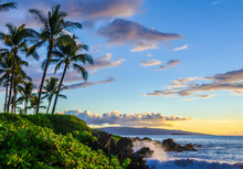 Beautiful Tropical Beach At Sunset. Palm Trees And Lush Local Foliage.  Water Splashing On Lava Rocks.  Tourist Destination Location At Maui, Hawaii