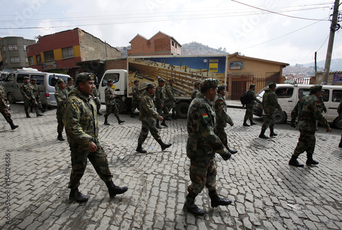 Bolivian low ranking Army officers march during the third