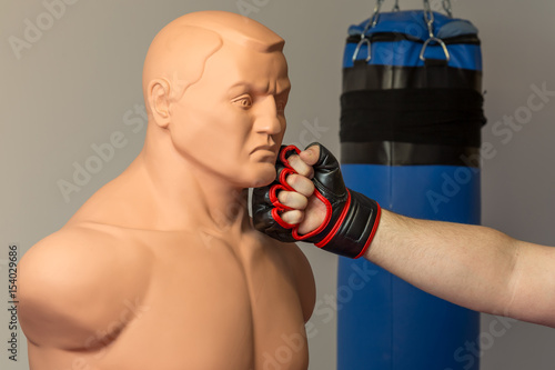 Caucasian mma fighter wearing red mix martial arts open fingers gloves punching Canvas Print