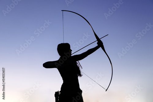 Female ginger hair archer shooting targets with her bow and arrow Wallpaper Mural