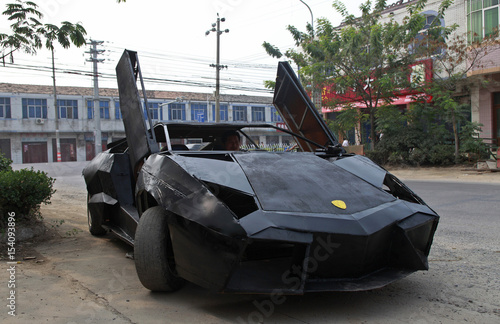 A Friend Of Wang Jian Sits In A Hand Made Replica Of A Lamborghini