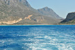the waves from the ship on the water on background of islands hills of Islands Crete Greece